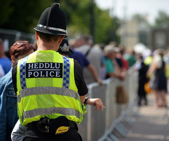 Welsh policeman talking to the public